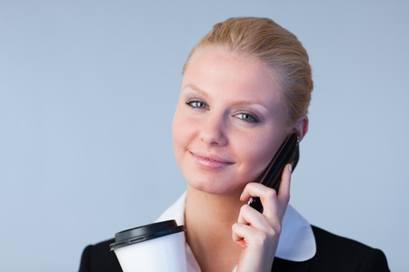 Radiant woman talking on the phone holding photo