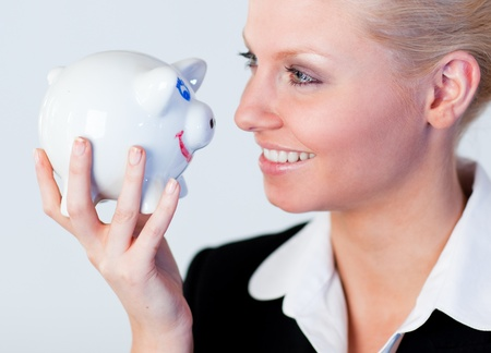 Young business woman holding a piggy Bank photo