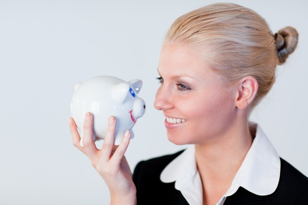 Smiling business woman holding a piggy Bank photo