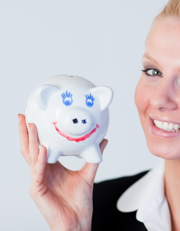 Bright business woman holding a piggy Bank photo