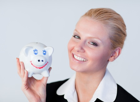 Pretty business woman holding a piggy Bank photo