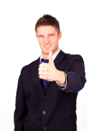 Handsome businessman with his thumb up photo