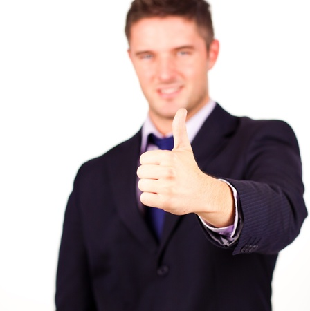 Handsome businessman with his thumb up against a white background Stock Photo - 10109645