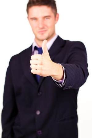 Smiling businessman with his thumb up against a white background Stock Photo - 10110350