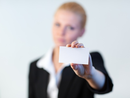 Business woman holding out a business card photo
