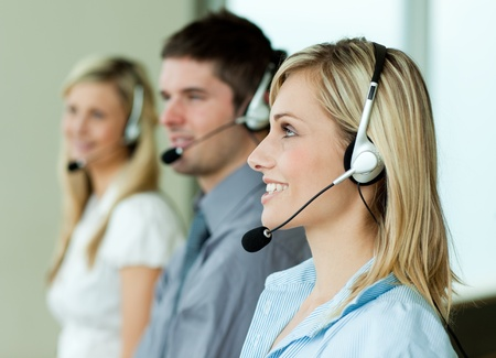 Businesspeople working with headsets photo
