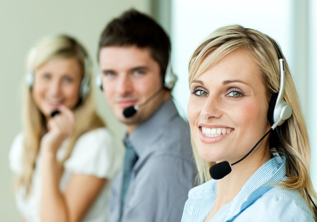 Young businesspeople smiling at the camera with headsets Stock Photo - 10111856