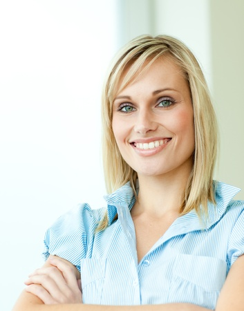 blonde blond: Businesswoman smiling with arms crossed