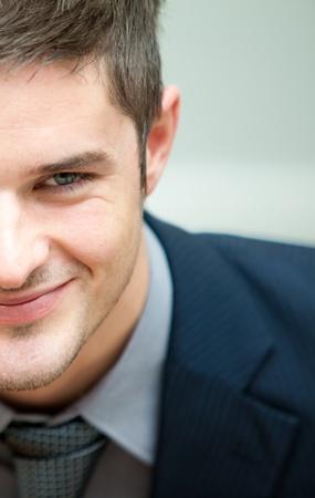 Half face of a businessman photo