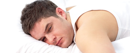 Man sleeping on bed photo