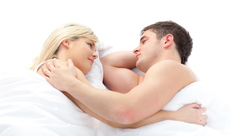 closeness: loving Couple relaxing on bed  Stock Photo
