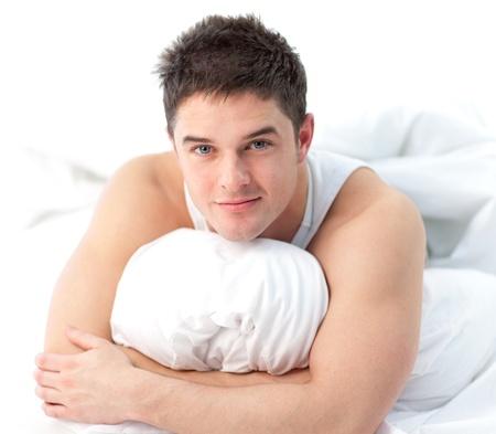 awaken: Man lying on bed awake Stock Photo