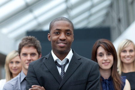 Afro-American businessman leading his team photo