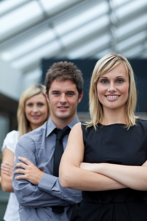 Beautiful businesswoman leading her team with folded arms Stock Photo - 10112532