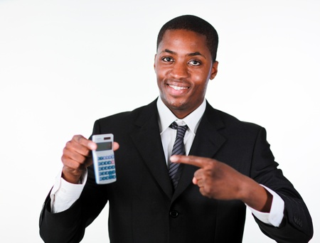 Young businessman with a calculator  photo