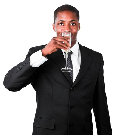 Friendly businessman drinking a glass of champagne photo