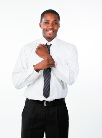 Ethnic businessman corrects a cuff link Stock Photo - 10109922