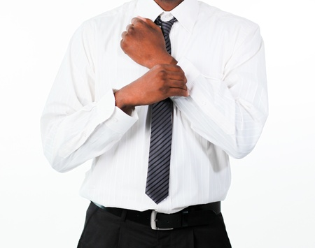 Close-up of businessman correcting a cuff link  Stock Photo - 10108368