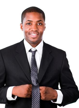 Happy businessman correcting his tie  photo