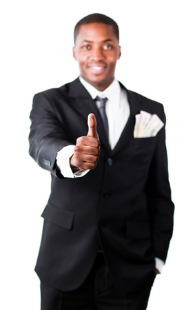 Happy businessman with dollars in a pocket showing thumb up photo