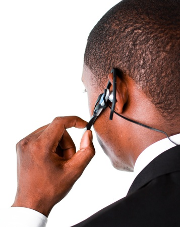 earpiece: Close-up of an Businessman showing his earpiece