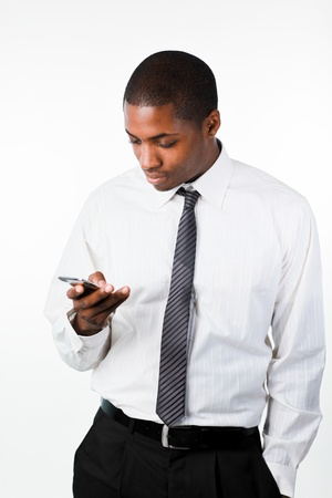 Young businessman sending a text message photo