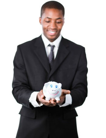 Portrait of an handsome American businessman holding a piggy bank with focus on piggy bank photo