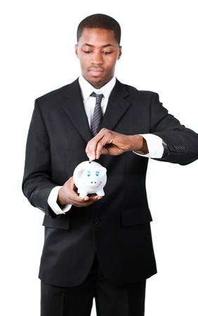 Portrait of a Businessman putting money in his piggy bank  photo