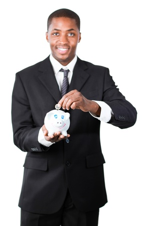 Friendly Afro-American businessman putting money in his piggy bank Stock Photo - 10109628