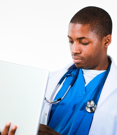 Young African doctor working on a laptop Stock Photo - 10108846