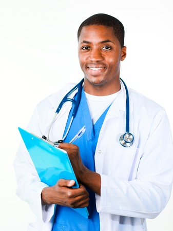 Friendly Afro-American doctor holding a clipboard and smiling at the camera photo