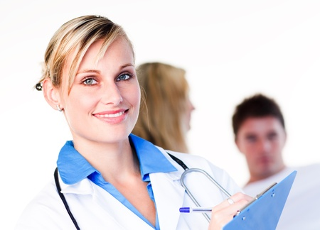Portrait of a blonde doctor with a patient Stock Photo - 10108524