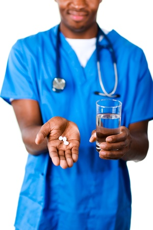 Close-up of an Young doctor holding pills and glass of water photo