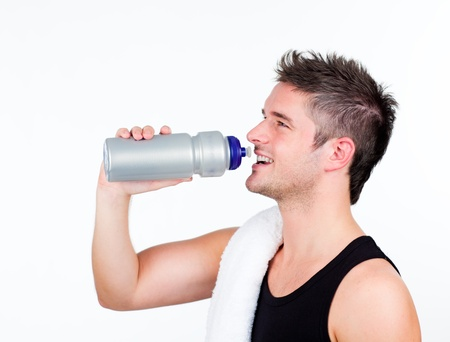 athlethic young man holding a sports bottle photo