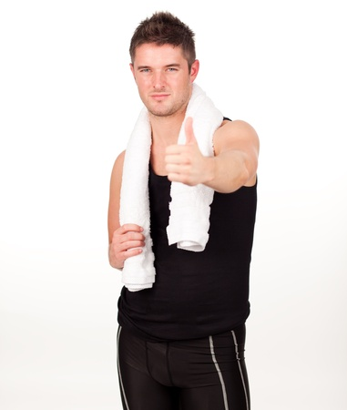 Sporting man with his thumbs up to the camera photo