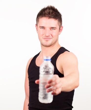 Happy Sportsman holding water bottle photo