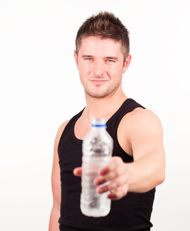Happy Sportsman holding water bottle photo