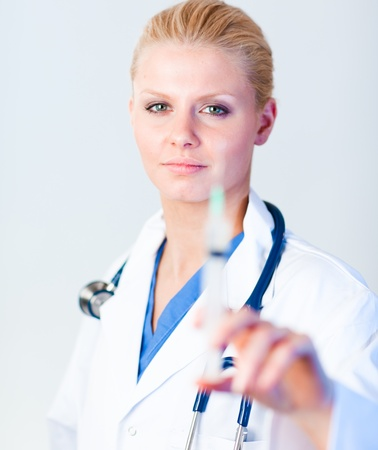 Serious Doctor holding a needle with hint of a smile Stock Photo - 10110227