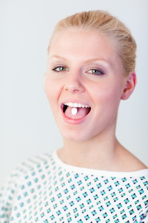 Patient with a pill in her mouth  Stock Photo - 10112391