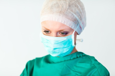 Pretty female surgeon with a mask  photo