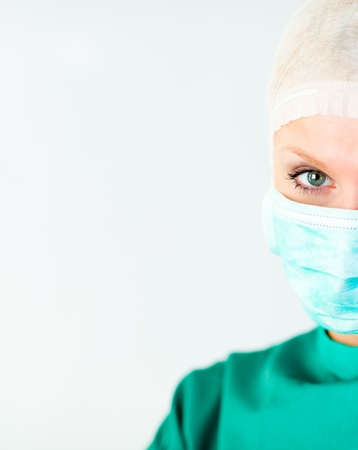 Attractive female doctor with a mask  photo
