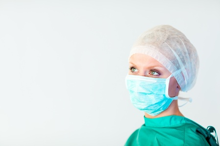 surgeon: surgeon looking away from camera  Stock Photo