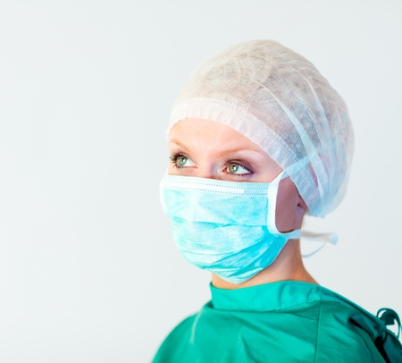 looking away from camera: surgeon looking away from camera  Stock Photo
