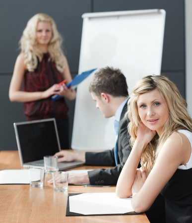 woman presenting at a business teamwork meeting photo