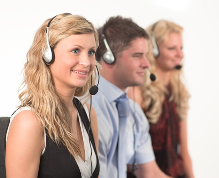 Three people in a call centre photo