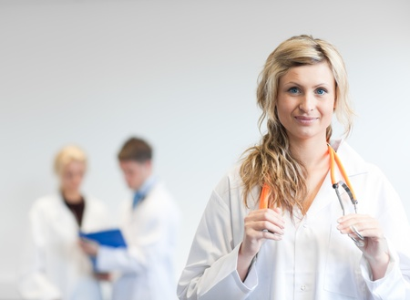 Attractive female surgeon with her team behind her Stock Photo - 10111101