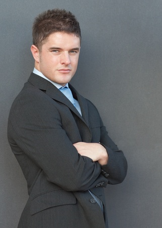 Businessman with his arms folded photo