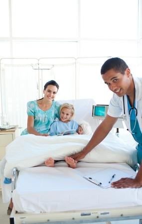 Attractive doctor examining little girl  photo