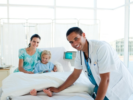 Male doctor smiling at the camera photo