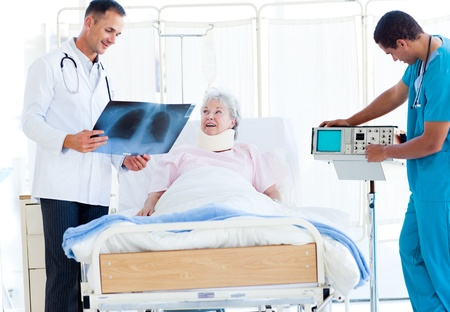 Smiling doctor showing an x-ray to a female patient Stock Photo - 10111866